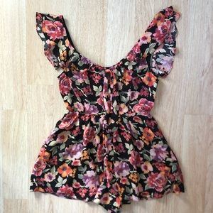 Urban Outfitters floral ruffled open back romper